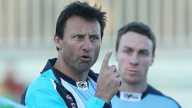 Blues coach Laurie Daley talks to players during a New South Wales Blues State of Origin training session.