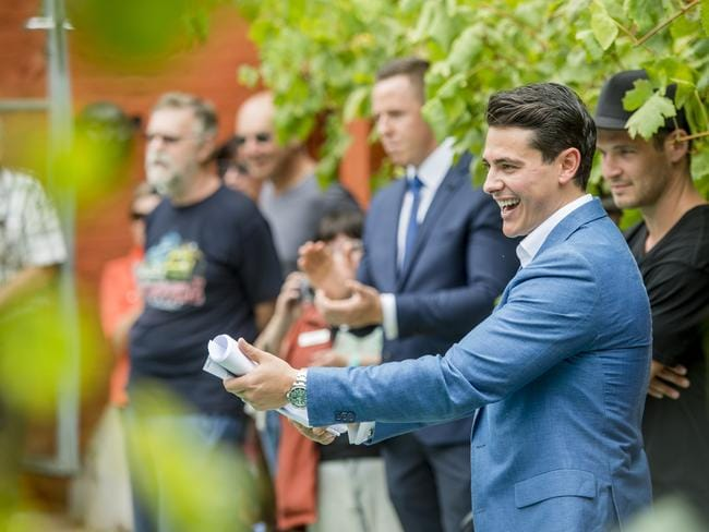 Wilson Real Estate agent Martin Fox auctioning in Melbourne where, like in Sydney, investors and foreign buyers are giving first timers a run for their money. Picture: Jason Edwards