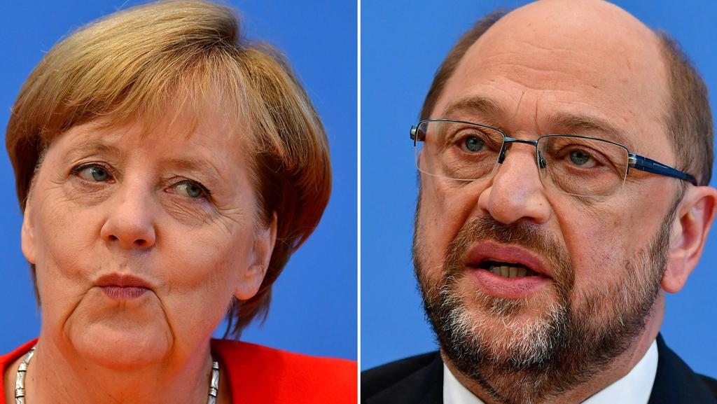 German Chancellor Angela Merkel, also leader of the conservative Christian Democratic Union (CDU) party and Martin Schulz, leader of Germany's social democratic SPD party and candidate for Chancellor. Picture: AFP