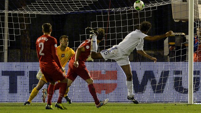 San Marino defender Alessandro Della Valle shoots and scores against Poland during a FIFA World Cup 2014 qualifying match.