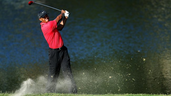 Tiger Woods plays his dropped ball on the 14th hole during the final round of The Players Championshi in Ponte Vedra Beach. Picture: Andy Lyons