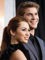 "<p>Cast member Miley Cyrus and co-star Liam Hemsworth pose at the premiere of ""The Last Song"" at the Arclight theatre in Hollywood, California March 25, 2010. The movie opens in the U.S. on March 31.</p>"