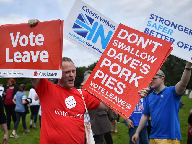 A campaigner for 'Vote Leave', from the official 'Leave' campaign organisation, holds a placard during a rally for 'Britain Stronger in Europe' in London before the Brexit vote. Picture: AFP