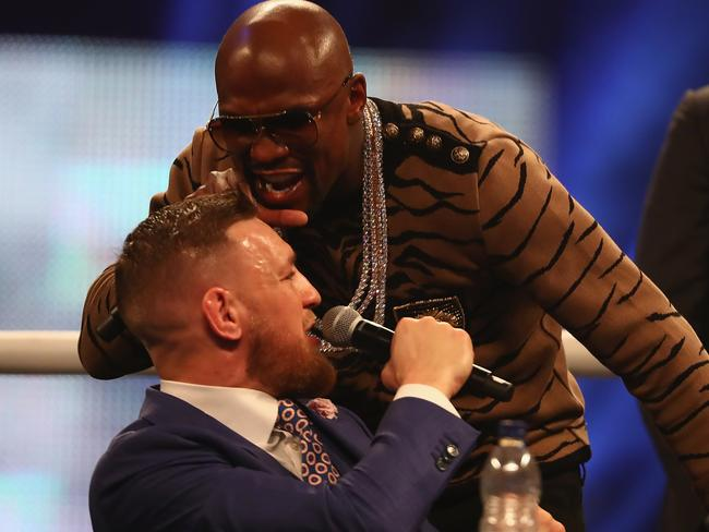 Floyd Mayweather Jr. and Conor McGregor during the press tour.