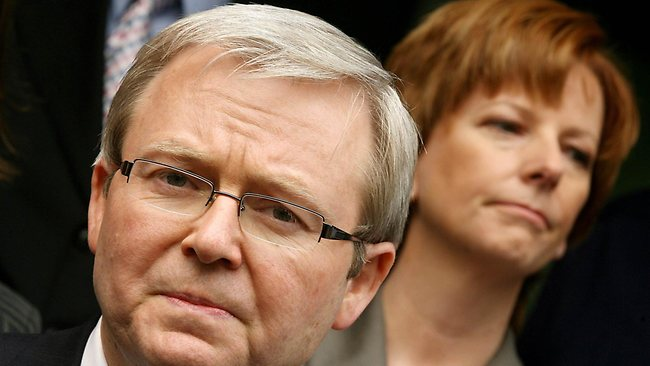 """(FILES) Photo taken on 13 Dec 2006 shows former Australian prime minister Kevin Rudd (L) and current prime minister Julia Gillard (R) as they speak to the media in Melbourne, 13 Dec 2006. A year after sweeping to power as Australia's first woman prime minister, Julia Gillard leads a minority government under attack over its major policies while failing dismally in the polls. In the lead-up to the anniversary of the party room coup which gave her the leadership on 24 Jun last year, support for her Labor administration is at a low not seen in 40 years and her personal popularity is plunging. """"It is in danger of going down as one of the worst governments of all time,"""" Australian National University academic John Wanna said of Gillard's first year in The Lodge. AFP PHOTO/FILES/William WEST"""