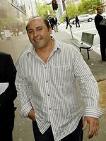 <p>Tony Mokbel smiles leaving a Magistrates' court hearing in 2005.</p>