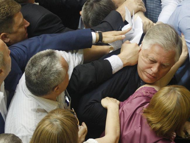 "Punching on ... Deputies of the All-Ukrainian Union ""Svoboda"" party attack the head of the Communist parliamentary faction Petro Symonenko (R) as they attempt to remove him from the hall during a Ukrainian parliament sitting in Kiev."