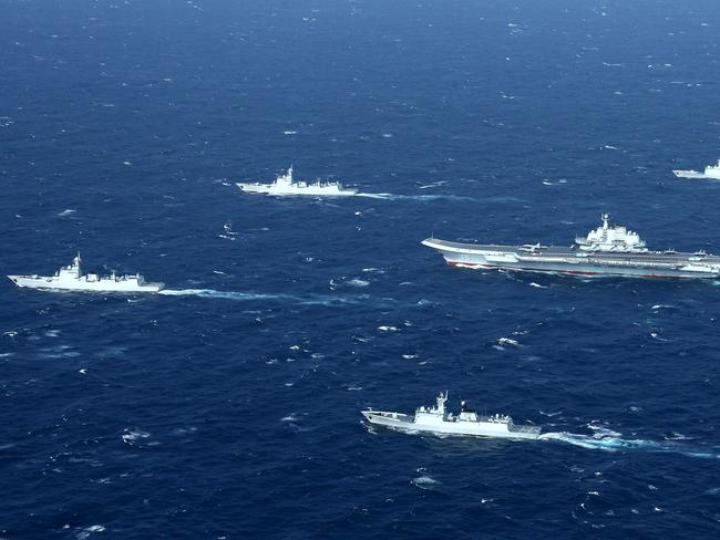 A Chinese navy formation, including the aircraft carrier Liaoning during military drills in the South China Sea. Picture: AFP