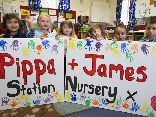 Children at the Old Fire Station nursery in Englefield, Berkshire, with their wedding poster. Picture: Stephen Lock/i-Images.