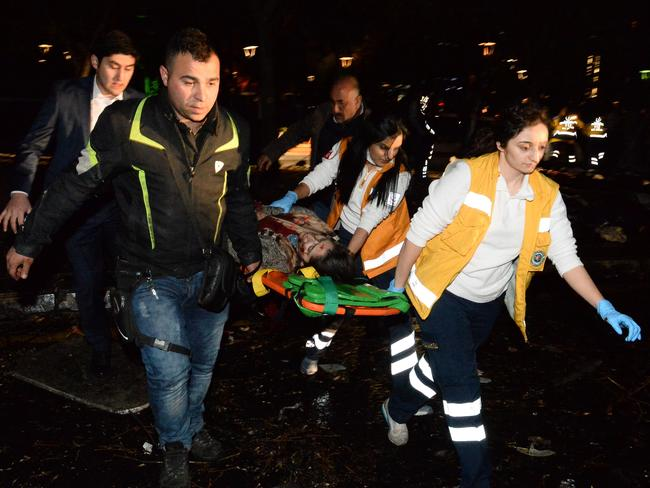 Emergency services help an injured person after an explosion in Ankara's central Kizilay district in Turkey. Picture: Defne Karadeniz/Getty Images