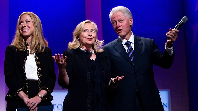 NEW YORK CITY- SEPTEMBER 22: Former US President Bill Clinton (R) stands on stage with his wife Hillary Rodham Clinton (C), Secretary of State, and their daughter Chelsea Clinton during the closing Plenary session of the seventh Annual Meeting of the Clinton Global Initiative (CGI) at the Sheraton New York Hotel on September 22, 2011 in New York City. Established in 2005 by former U.S. President Bill Clinton, the CGI assembles global leaders to develop and implement solutions to some of the world's most urgent problems. Daniel Berehulak/Getty Images/AFP== FOR NEWSPAPERS, INTERNET, TELCOS & TELEVISION USE ONLY ==