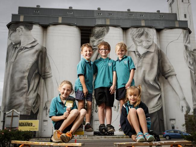 Ciara Johnson, Reef Gregor, Blake Thompson, Kiarah Leske and Macey Jacobs in front of their paintings on the 30-metre high Coonalpyn silo mural by artist Guido van Helten. Picture: Matt Turner