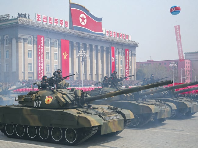 Soldiers in tanks take part in a military parade. Picture: AP