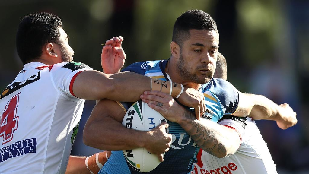 SYDNEY, AUSTRALIA — AUGUST 12: Jarryd Hayne of the Titans is tackled during the round 23 NRL match between the St George Illawarra Dragons and the Gold Coast Titans at UOW Jubilee Oval on August 12, 2017 in Sydney, Australia. (Photo by Mark Kolbe/Getty Images)