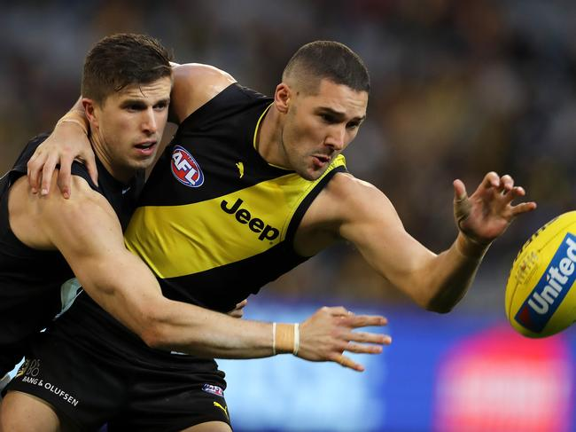 Richmond's Shaun Grigg and Carlton's Marc Murphy locked in battle. Picture: Michael Klein