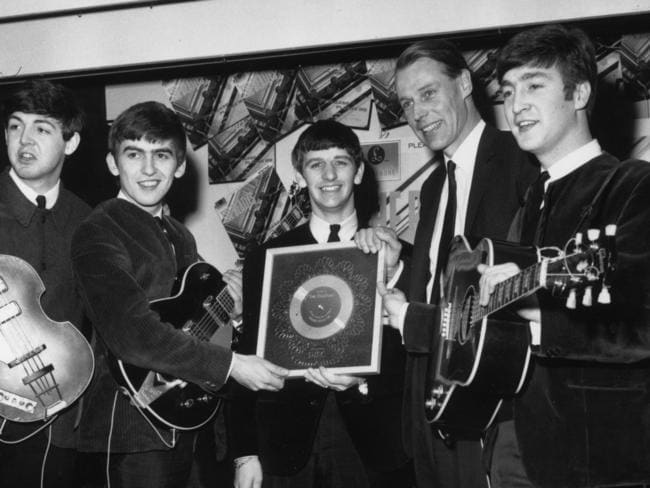 George Martin (second from the right) with members of the Beatles. Picture: Chris Ware/Keystone/Getty Images