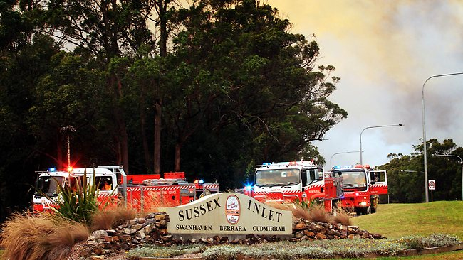 NSW Rural Fire Service firefighters hold the line of the Shoalhaven fire at Princess Highway near Sussex Inlet / Pic: Craig Greenhill