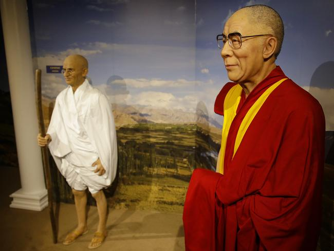 Wax Gandhi hangs out with the wax Dalai Lama. Picture: AP/Stephan Savoia