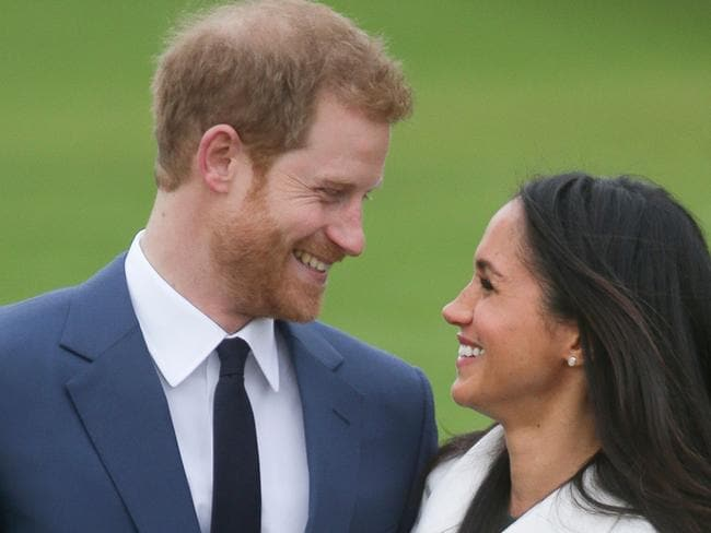 Britain's Prince Harry standing with his fiancee US actress Meghan Markle. Picture: AFP
