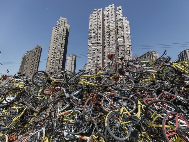 Ride-sharing bicycles from all major companies sit in a pile. Photographer: Qilai Shen/Bloomberg via Getty Images