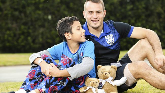 Jarnan Barker, 11, from Dubbo, a patient at Westmead Children's Hospital, looks up to Josh Reynolds.