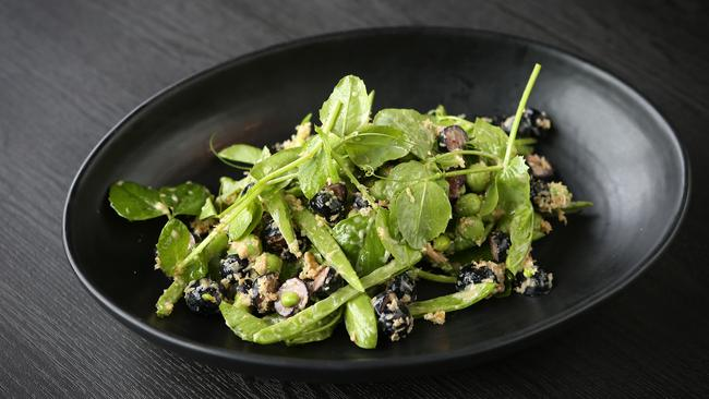Freshly podded peas and shoots tossed through a horseradish dressing with sharp blueberries for bite. Picture: Rebecca Michael