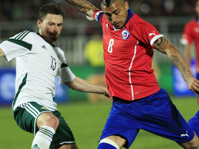 Key Chile player Arturo Vidal is facing a race against time to be fit for Saturday morning's World Cup clash against Australia.
