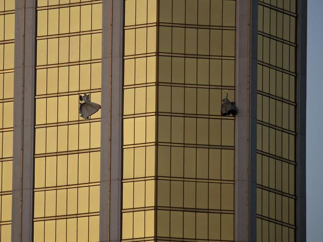 Drapes billow out of broken windows at the Mandalay Bay resort and casino on the Las Vegas Strip, following the mass shooting. Picture: AP