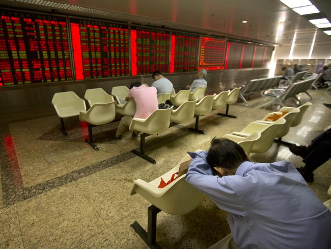A Chinese investor takes a nap in a brokerage house in Beijing.