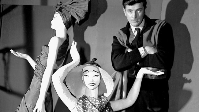 Hubert de Givenchy poses with mannequins in his shop in Paris. . (AP Photo, File)
