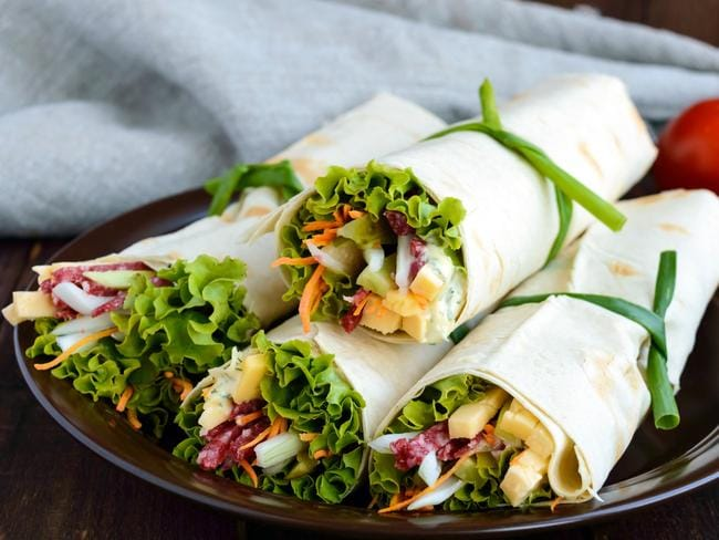 If you have a wrap for lunch you could have half at 11am when hunger hits, and save the other half for later. Picture: iStock