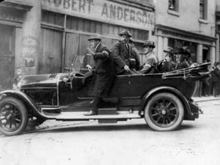 1923. A carload of 'specials' operating in Little Collins St (street) Melbourne during the police strike. Special Civilian Force. Special Constables. History. Historical image. Australia. 1920s.