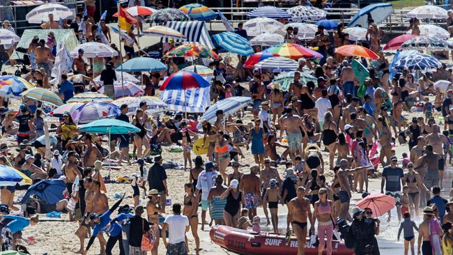 Crowds flocked to Bondi Beach as the mercury kept climbing through the day. Picture: Jenny Evans