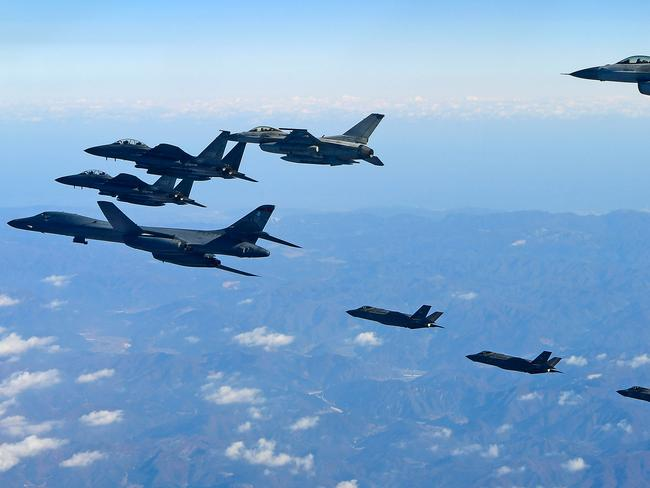US air force B-1B bomber (L), South Korea and US fighter jets fly over the Korean Peninsula during the Vigilant air combat exercise (ACE) in December. Picture: Getty