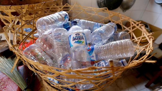 Recycled water bottles to be used to store bootlegged arak. A traditional drink, arak is a clear, rice-based spirit but batches cut with methanol can have disastrous effects.