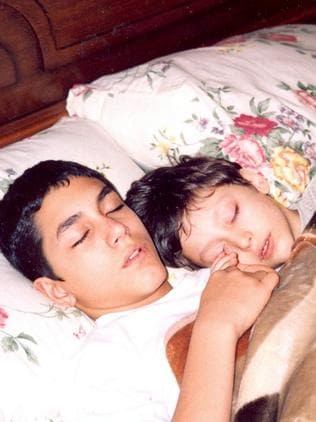 Innocent ... A younger Pouria Nourmohammadi, left, asleep with his younger brother Ilia Nourmohammadi
