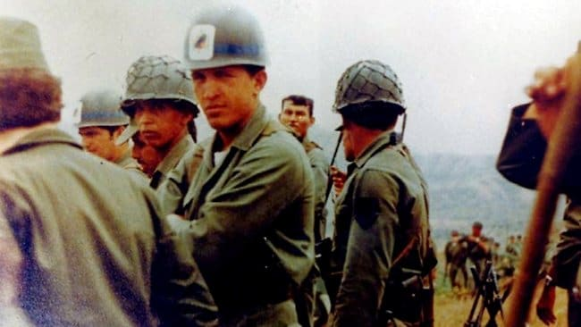 In this undated photo Hugo Chavez looks at the camera during a military exercise in Venezuela. Picture: Miraflores Press Office/AP