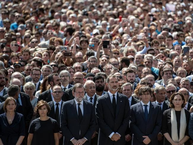 King Felipe VI of Spain and Spanish Prime Minister Mariano Rajoy join other dignitaries and residents of Barcelona in Placa de Catalunya to observe a one minute's silence for the victims. Picture: Getty