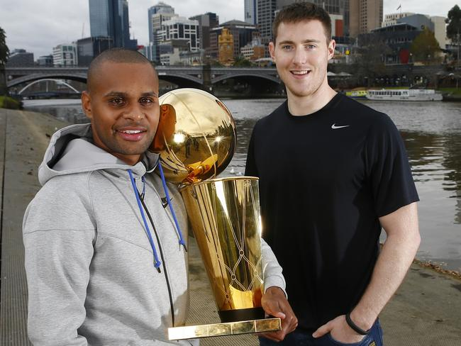 Australians Patty Mills and Aron Baynes back home with the NBA's Larry O'Brien championship trophy.