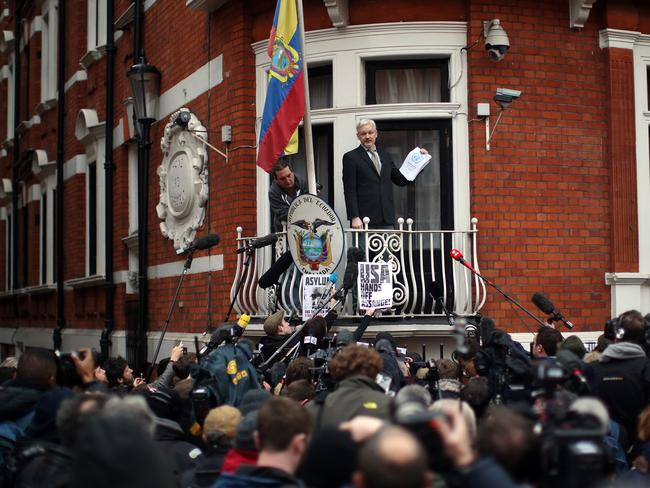 Hitting back ... Julian Assange speaks from the balcony of the Ecuadorean embassy where he continues to seek asylum. Picture: Carl Court/Getty Images