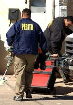 <p>Forensic officers arrive at house in Ciudad Juarez following discovery of 11 bodies found buried in backyard, with man who lived in house confirming he helped kill and bury victims on orders of drug smugglers cartel.</p>