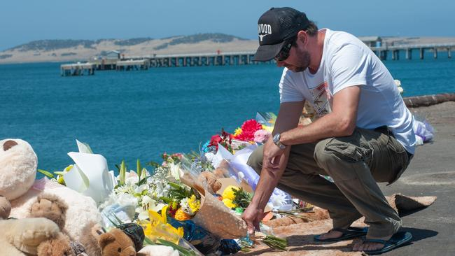The brother of Damien Little, Shannon Little, visits the growing memorial site at Port Lincoln's main wharf. Picture: Ivon Perrin
