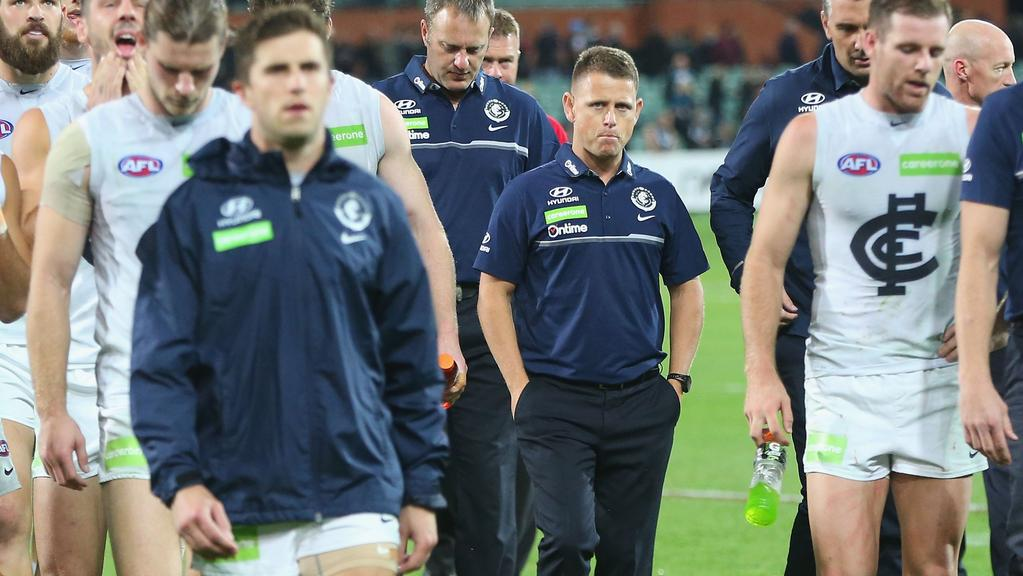 ADELAIDE, AUSTRALIA — APRIL 21: Blues head coach Brendon Bolton looks dejected as Marc Murphy of the Blues leads the team off after defeat during the round five AFL match between the Port Adelaide Power and thew Carlton Blues at Adelaide Oval on April 21, 2017 in Adelaide, Australia. (Photo by Michael Dodge/Getty Images)