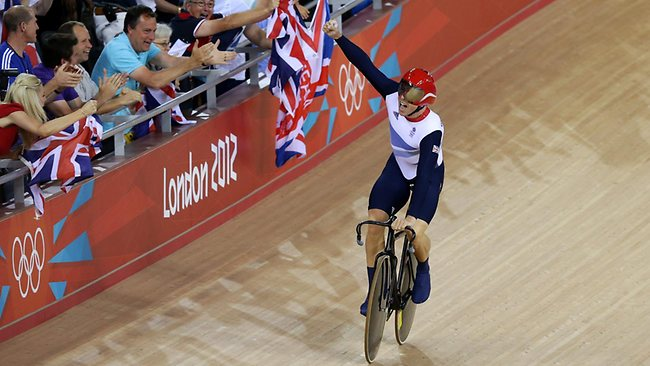 Legend ... Sir Chris Hoy celebrates his record-equalling fifth Olympic gold medal.