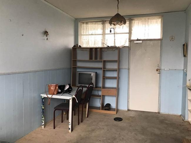 Judging by the grubby walls and carpet, it looks like it wasn't cleaned. Picture: Central Sydney Realty