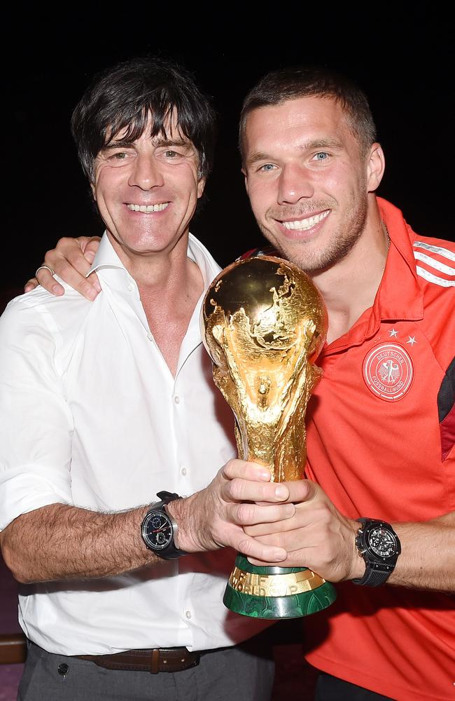 Germany head coach Joachim Loew and Lukas Podolski.