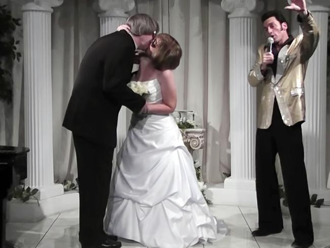 David Allen Turpin and his wife, Louise Anna Turpin, kiss while celebrating a renewal of their wedding vows with Elvis impersonator Kent Ripley, at right, in Las Vegas. Picture: A Elvis Chapel via AP