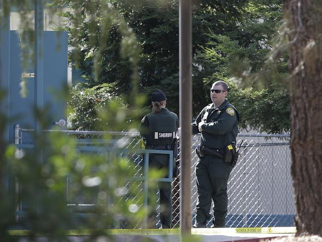 Law enforcement officers are seen at an elementary school in the community of Rancho Tehama Reserve, where a gunman opened fire Tuesday, Nov. 14, 2017, in Corning, California. Picture: AP Photo/Rich Pedroncelli