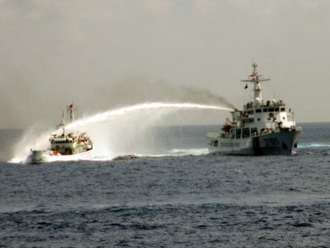 A Chinese coast guard vessel douses a Vietnamese fishing boat with water in the contested waters of the South China Sea. Picture: AP