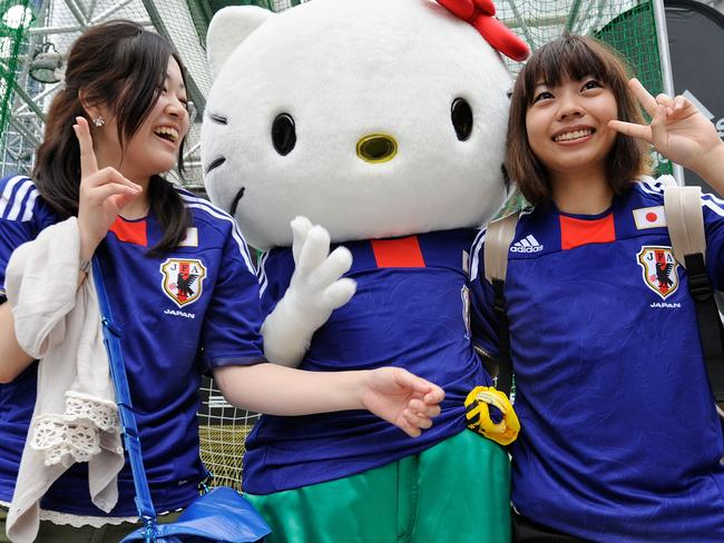 Supporting Japan's soccer team.